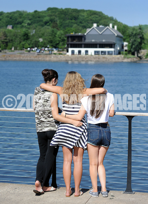 NEW HOPE, PA - JUNE 02:  From left, Lauren Fitzpatrick, 18, Allie Becker, 19, and Capri Wagner, 18 all of Newtown, Pennsylvania look out onto the Delaware River on a warm afternoon June 2, 2014 in New Hope, Pennsylvania.  The temperature reached 82 degrees in New Hope and is expected to remain in the mid-80's for the next few days. (Photo by William Thomas Cain/Cain Images) (William Thomas Cain)