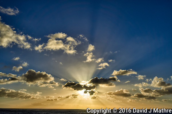 Morning sun and clouds with Crepuscular rays (God's rays) from the deck of the MV World Odyssey while traveling across the Pacific Ocean. Image taken with a Leica T camera and 23 mm f/2 lens (ISO 100, 23 mm, f/14, 1/500 sec). Raw image processed with Capture One Pro (including correction of white-balance). (David J Mathre)