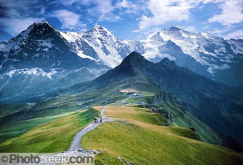 From Männlichen Gipfel, see Eiger, Mönch, and Jungfrau in the Berner Oberland, Switzerland, the Alps, Europe.