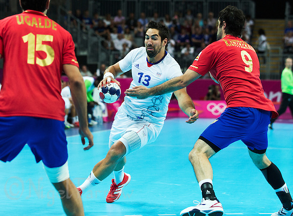 08 AUG 2012 - LONDON, GBR - Nikola Karabatic (FRA) of France (centre) looks for a way through the Spanish defence during the men's London 2012 Olympic Games quarter final match at the Basketball Arena in the Olympic Park, in Stratford, London, Great Britain .(PHOTO (C) 2012 NIGEL FARROW) (NIGEL FARROW/(C) 2012 NIGEL FARROW)