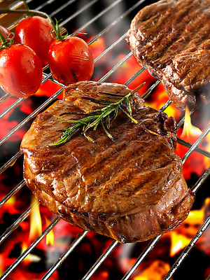 Barbecue fillet steak cooking on a BBQ grill (By food photographer Paul Williams. )