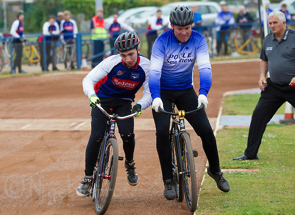 14 JUN 2015 - IPSWICH, GBR - Ashley Hill (left) of Ipswich Eagles challenges Steve Harris (right) of Poole Comets for the best line into the first bend during their Elite League cycle speedway fixture at Whitton Sports and Community Centre in Ipswich, Suffolk, Great Britain (PHOTO COPYRIGHT © 2015 NIGEL FARROW, ALL RIGHTS RESERVED) (NIGEL FARROW/COPYRIGHT © 2015 NIGEL FARROW : www.nigelfarrow.com)