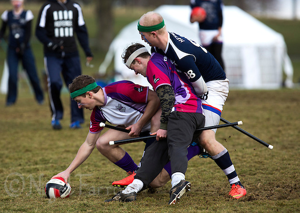 08 MAR 2015 - NOTTINGHAM, GBR - Jerome Vaugarny (left) from Loughborough Longshots attempts to retrieve the quaffle as his team mate Charlie Guy tries to hold off Tom Heynes (right) from Radcliffe Chimeras during the 2015 British Quidditch Cup semi final at Woollaton Hall and Deer Park in Nottingham, Great Britain (PHOTO COPYRIGHT © 2015 NIGEL FARROW, ALL RIGHTS RESERVED) (NIGEL FARROW/COPYRIGHT © 2015 NIGEL FARROW : www.nigelfarrow.com)