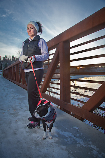 Christine Ann Ronellenfitch with her dog, Tank, on the bridge at the east end of Westchester Lagoon, Anchorage (Clark James Mishler)