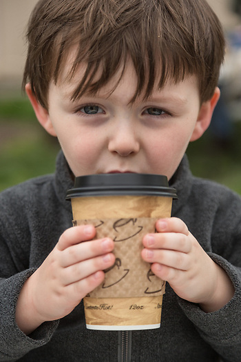Henry Swenton savors a cup of hot chocolate at the Calistoga Saturday Market. (Clark James Mishler)