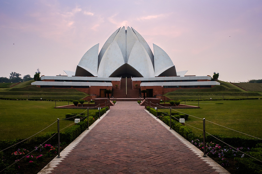 "NEW DELHI, INDIA - CIRCA OCTOBER 2016: The Lotus Temple in Delhi, also known as the Bahai House of Worship. This is a popular tourist attraction in Delhi. The building is composed of 27 free-standing marble-clad ""petals"" arranged in clusters of three to form nine sides, with nine doors opening. (Daniel Korzeniewski)"