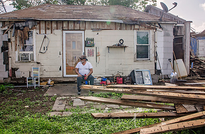 Joe Guerra sits in front of his storm-damaged house as he waits for his daughter, Oct. 4, 2017, in Refugio, Texas. Refugio was hard-hit by Hurricane Harvey in late August and continues to recover. Many homeowners, like Mr. Guerra, experienced so much damage that they will have to demolish their homes and rebuild. (Photo by Carmen K. Sisson) (Carmen K. Sisson/Cloudybright)