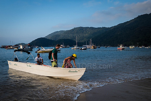 A water taxi offloads passengers stright onto the beach at Abraao on the island of Ilha Grande, Brazil. Photo by Andrew Tobin/Tobinators Ltd (Andrew Tobin/Tobinators)