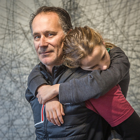 Petaluma photographer Bill Richardson carries his twelve year old daughter, Veronica, at the Indian Springs Art Gallery in Calistoga (Clark James Mishler)
