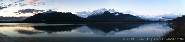 The sun rises above the Chilkat River near Haines, Alaska. The mountains the background are of the Chilkat Range and Takhinsha Range. SPECIAL NOTE: This iPhone photo is composed of multiple iPhone photos stitched together as a panorama. (John L. Dengler)