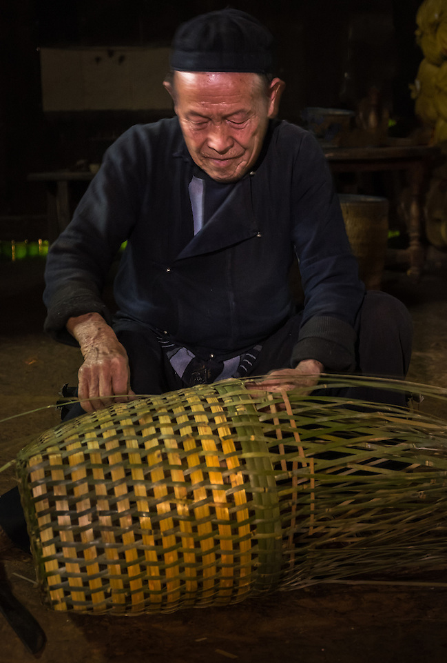 SAPA, VIETNAM - CIRCA SEPTEMBER 2014:  Old man from the Black Hmong minority working on handicrafts in the Ta Phin Village near Sapa, north Vietnam. (Daniel Korzeniewski)