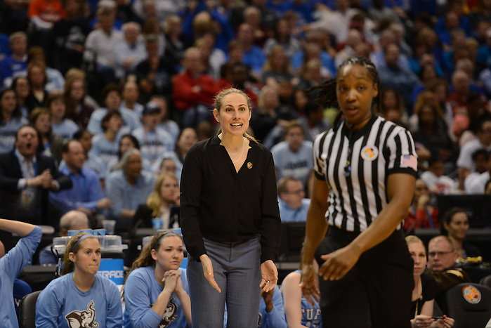 Coach Carla Berube looks to referee for foul call explanation during the NCAA Div. III championship game. (Daily Photo)