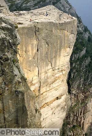 A side view reveals a long vertical crack in the Pulpit (Prekestolen), 1959 feet above Lysefjord, in Forsand municipality, Rogaland county, Ryfylke traditional district, Norway, Europe.