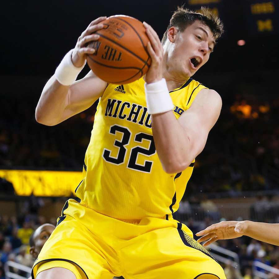 Feb 22, 2015; Ann Arbor, MI, USA; Michigan Wolverines forward Ricky Doyle (32) goes to the basket in the first half against the Ohio State Buckeyes at Crisler Center. Mandatory Credit: Rick Osentoski-USA TODAY Sports (Rick Osentoski/Rick Osentoski-USA TODAY Sports)