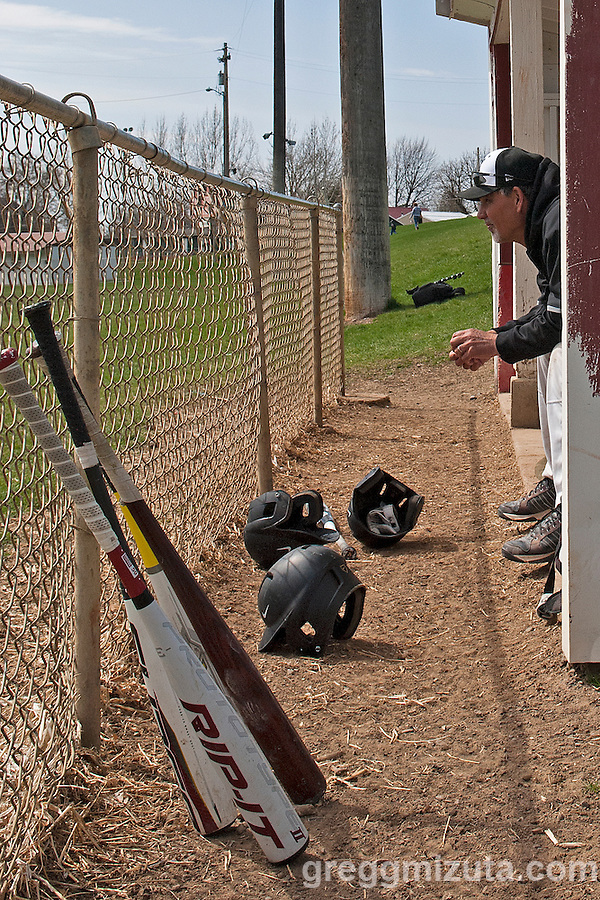 Vale head coach, Rick Yraguen watches from the dugout during the Vale-Weiser game on April 7, 2012 at Walter Johnson Memorial Field in Weiser, Idaho. Vale won the game in 5 innings, 12-0, to improve its record on the season to 6-5 with conference play starting next week. (Gregg Mizuta)