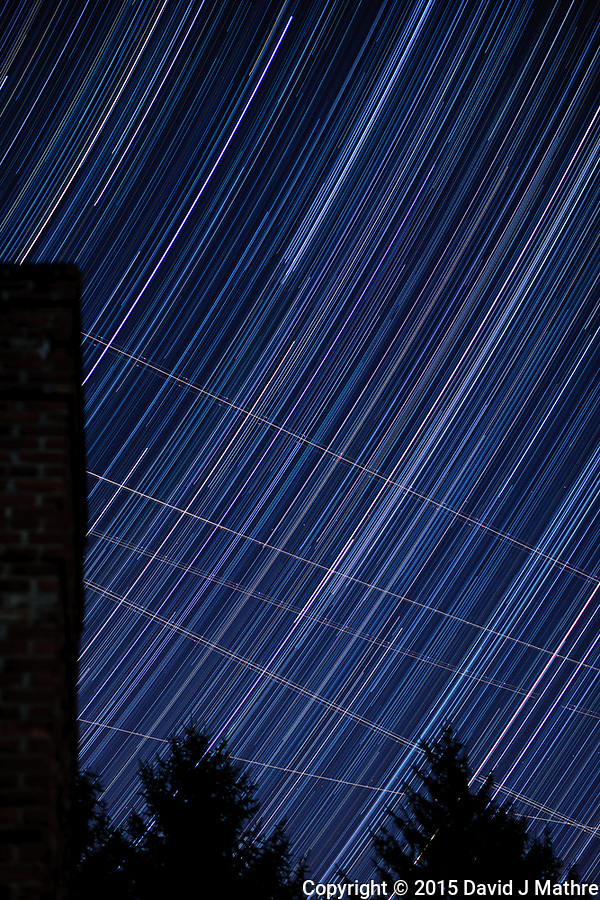 Star trails looking east from my backyard. Autumn night sky in New Jersey. Composite of 251 images taken with a Nikon D3x camera and 58 mm f/1.4 lens (ISO 100, 58 mm, f/2, 30 sec). (David J Mathre)