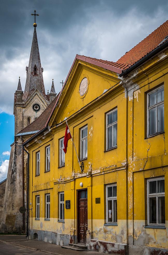 LATVIA, CESIS - CIRCA JUNE 2014: View of  typical street in Cesis, St. John's Church tower in the background. (Daniel Korzeniewski)