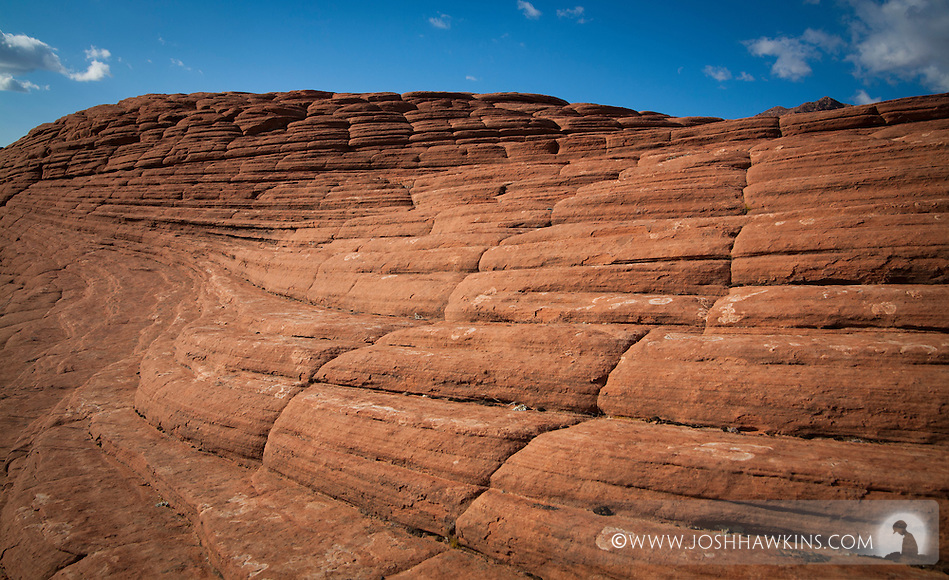 Petrified sand dunes in Snow Canyon State Park outside St. George, Utah.  The sand dunes were originally deposited more than 183 million years ago. (Josh Hawkins)