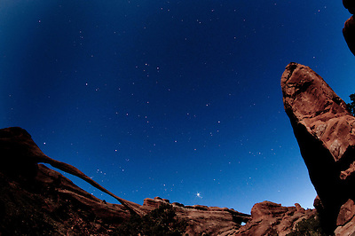 Landscape Arch Under Stars and Moonlight, Arches National Park, Utah, US (Roddy Scheer)