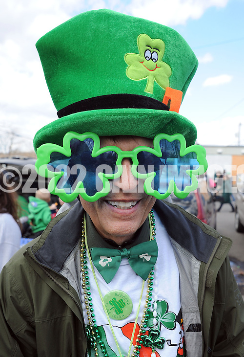 FAIRLESS HILLS, PA -  MARCH 15: Dan Mcauliffe of Langhorne, Pennsylvania wears a green hat and shamrock sunglasses during the St. Patrick's Day Parade March 15, 2014 in Fairless Hills, Pennsylvania.  (Photo by William Thomas Cain/Cain Images) (William Thomas Cain)