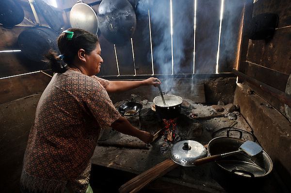 A woman using lamtoro wood to cook, Bangga, Gorontalo, Sulawesi, Indonesia. (Matthew Oldfield)