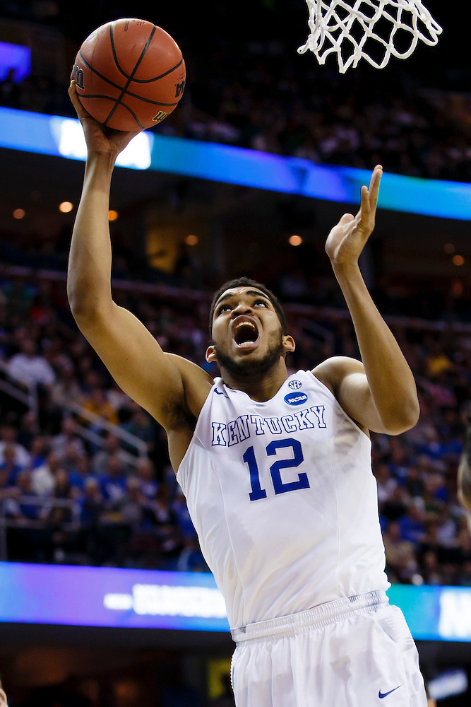 Mar 28, 2015; Cleveland, OH, USA; Kentucky Wildcats forward Karl-Anthony Towns (12) shoots against the Notre Dame Fighting Irish in the finals of the midwest regional of the 2015 NCAA Tournament at Quicken Loans Arena. Mandatory Credit: Rick Osentoski-USA TODAY Sports (Rick Osentoski/Rick Osentoski-USA TODAY Sports)