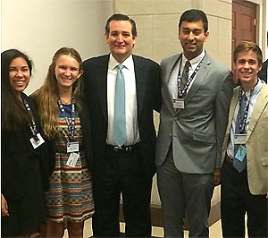 Carnegie Vanguard HS students Bonnie Sullivan (2nd from L), and Connor Burwell (far R) pose with Senator Ted Cruz.