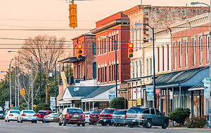 Cars travel down Broad Street as the sun sets on downtown, Feb. 14, 2015, in Selma, Alabama. (Photo by Carmen K. Sisson/Cloudybright) (Carmen K. Sisson/Cloudybright)