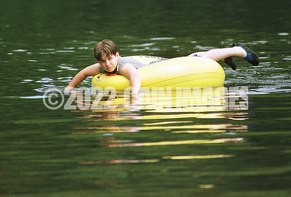 A boy tubing down the Delaware River  in Tinicum, Pennsylvania. (Photo by William Thomas Cain/Cain Images) (William Thomas Cain)