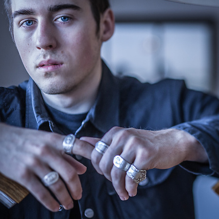 "Photographer Michael Huff with his ""spoon"" rings, Anchorage (© Clark James Mishler)"