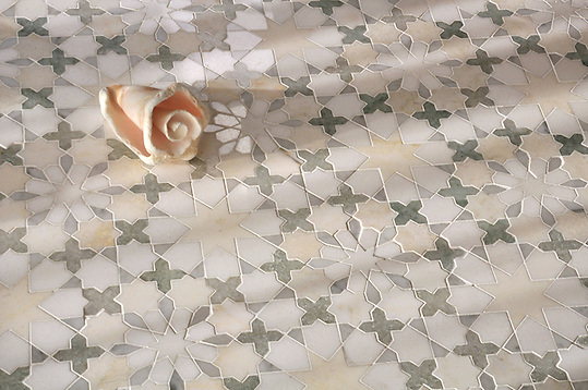 Granada, a natural stone waterjet mosaic shown in Heavenly Cream honed, Ming Green, Carrara, Thassos polished marbles is part of the Miraflores Collection by Paul Schatz for New Ravenna Mosaics. (Picasa)