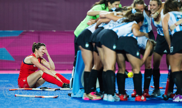 08 AUG 2012 - LONDON, GBR - Anne Panter (GBR) of Great Britain wipes her eyes as Argentinian (ARG) players celebrate winning the London 2012 Olympic Games semi final hockey match between the two teams at the Riverbank Arena in Stratford, London, Great Britain (PHOTO (C) 2012 NIGEL FARROW) (NIGEL FARROW/(C) 2012 NIGEL FARROW)