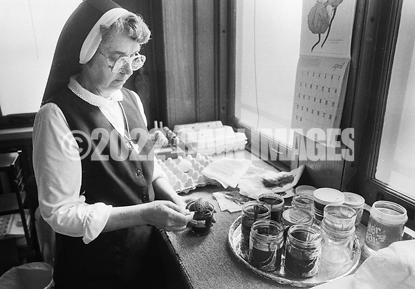 Sister Josaphat Slobodian dyes an egg while she does Ukrainian eggs, or pysanky, Tuesday, May 01, 1990 at Sisters of Saint Basil The Great motherhouse in Glenside, Pennsylvania. (Photo by William Thomas Cain/Cain Images) (William Thomas Cain/Cain Images)
