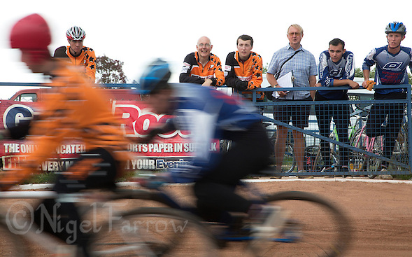 13 SEP 2014 - IPSWICH, GBR - Team members of Sheffield Stars (in orange) and Hethersett Hawks (in blue and white) watch their team mates racing during the second semi final of the 2014 British Open Club Cycle Speedway Championships at Whitton Sports & Community Centre in Ipswich, Great Britain (PHOTO COPYRIGHT © 2014 NIGEL FARROW, ALL RIGHTS RESERVED) (NIGEL FARROW/COPYRIGHT © 2014 NIGEL FARROW : www.nigelfarrow.com)