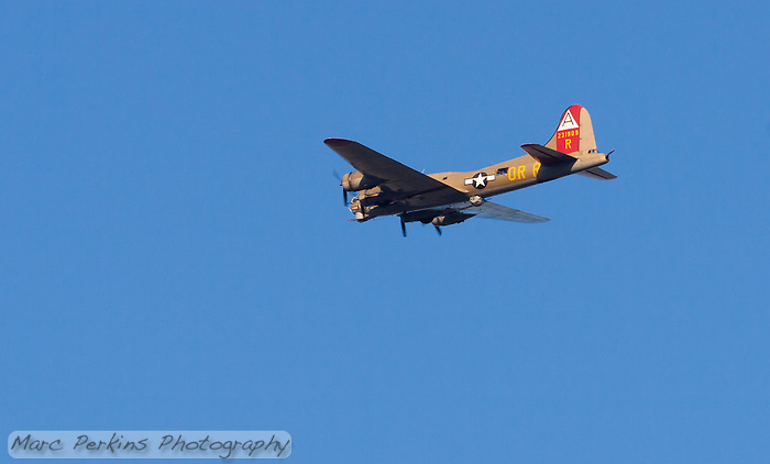 "The B-17 ""Flying Fortress"" bomber ""Nine-Oh-Nine"", tail number 231909, flying over Orange County, CA on May 12, 2013.  Taken about an hour before sunset, the plane's left side is clearly visible.  The vintage plane has been resored by The Collins Foundation to it's WWII (World War 2) configuration, after having served in nuclear bomb testing in the 1950's, being sold as scrap, and being converted into a forest-fire supression plane. (Marc C. Perkins)"