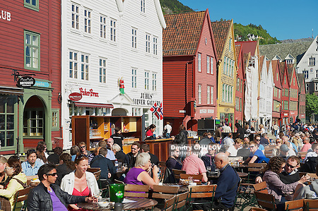 BERGEN, NORWAY - JUNE 06, 2010: Unidentified people have lunch at street restaurants at Bruggen in Bergen, Norway. Bruggen is a UNESCO world Heritge site. (Dmitry Chulov)