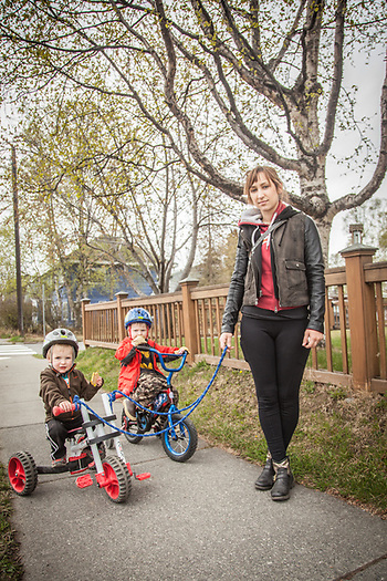 Jovana Karapandzic with Oliver (2) and Elliott (4), two neighbor kids in her care for the summer, Anchorage. (© Clark James Mishler)