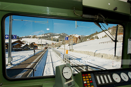 CIRCA MONTREUX, SWITZERLAND - DECEMBER 09, 2009: Golden pass train locomotive arrives to a station. The Golden Pass is a train line in the Swiss Alps which connect Montreux to Lucerne, the line is served by three companies with panoramic trains. (Dmitry Chulov)