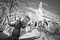 Rachel Hockenbarger, protesting in front of St. Mark's Episcopal Church in Salt Lake City.  She is a member of the Westboro Baptist Church and daughter of Pastor Fred Phelps. She works on legal/logistical details for WBC.  The Westboro Baptist Church has become notorious in the United States for picketing the funerals of fallen US soldiers.  Their claim is that god is punishing America for allowing gay rights. (Dan Morris)