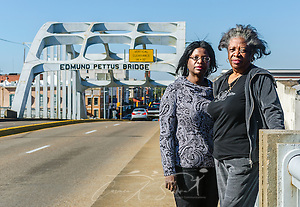 "Writer and playwright Cheryl L. Davis, left, stands with her mother, Bruce Davis, on the Edmund Pettus Bridge, Feb. 7, 2015, in Selma, Alabama. The women traveled from New York to see the historic site where civil rights activists were attacked by law enforcement during ""Bloody Sunday,"" March 7, 1965. Cheryl L. Davis is currently working on ""Bridges,"" a musical that mentions the 1965 civil rights march from Selma to Montgomery. The production is slated for production February 2016 in California. (Photo by Carmen K. Sisson/Cloudybright) (Carmen K. Sisson/Cloudybright)"