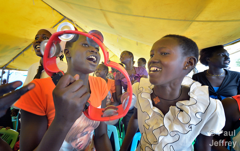 Women sing during a Roman Catholic Mass on Easter morning, April 5, inside a United Nations base in Juba, South Sudan, where some 34,000 people have sought protection since violence broke out in December 2013. More than 112,000 people currently live on UN bases in the war-torn country, most of them afraid of tribally targeted violence. The Catholic Church has maintained a pastoral presence inside the camps. (Paul Jeffrey)