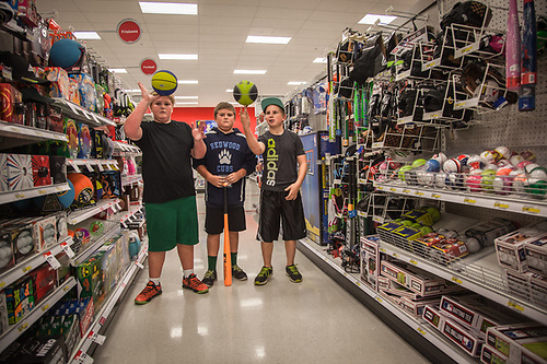 "Brothers and Ben and Tommy McPhee with friend, Jimmy, test out the athletic equipent at the Target store in Santa Rosa, California. ""Yes, its an enless suppy of athletic equipment for these guys."" -Michelle McPhee mlv_mcphee@yahoo.com (© Clark James Mishler)"