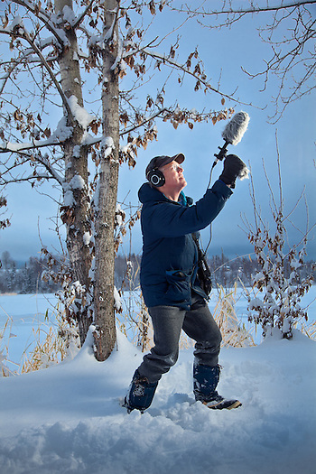 Cultural Anthropologist, Richard Nelson, records bird sounds near Westchester Lagoon, during a visit to Anchorage (Clark James Mishler)