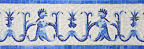 "8 1/4"" Pineapple People, a hand nipped jewel cut mosaic, is shown in, Lapis Lazuli, Iolite, and Covelite and an Absolute White background with a sea glass finish. (Sara Baldwin)"