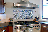 Amulet marble mosaic backsplash in Blue Macauba, Montevideo, Thassos, Chartreuse, Celeste, Travertine White (hct) -image courtesy of Mabley Handler Interior Design (New Ravenna Mosaics 2008)