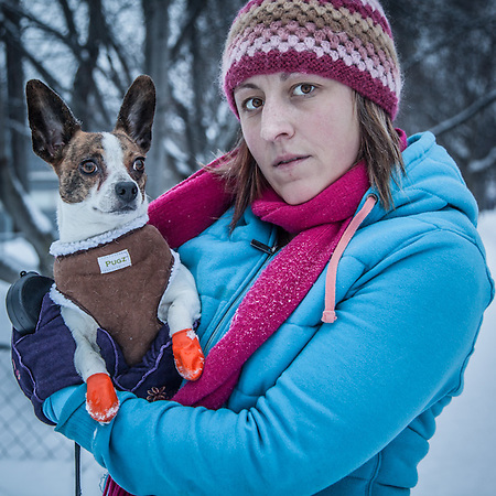 "Kristina Compelube and her dog, Peanut, in Anchorage's South Addition neighorhood.  ""I worked at Humpies for the past nine years.  I don't care if I never wait on another table."" (© Clark James Mishler)"