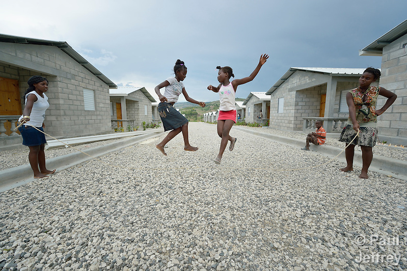 "Children jump rope in a model resettlement village constructed by the Lutheran World Federation in Gressier, Haiti. The settlement houses 150 families who were left homeless by the 2010 earthquake, and represents an intentional effort to ""build back better,"" creating a sustainable and democratic community. (Paul Jeffrey)"