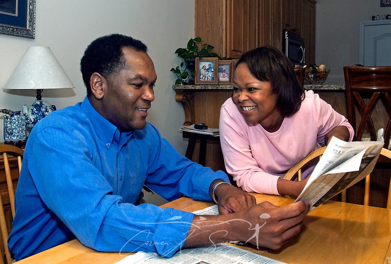 Levern Eady and his wife, Veda, talk over the real estate section in the kitchen of their home in Madison, Ala. Oct. 27, 2009. The Eadys chose to relocate to the Huntsville metropolitan area for the intellectually-rich environment it provides for their children as well as its future economic potential. Analysts expect Huntsville to fare well in the new economy thanks to its strong aerospace, defense, and biotech industries. (Photo by Carmen K. Sisson/Cloudybright) (Carmen K. Sisson/Cloudybright)