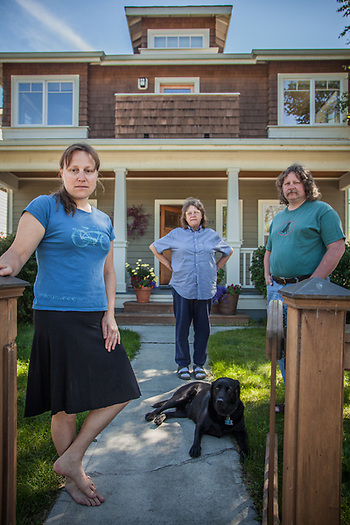 Morgan Warthin with her mother, Sally McIntosh her husband, Dan, and her dog, Kiki, in front of their house at the corner of 13th and G Street, Anchorage (Clark James Mishler)