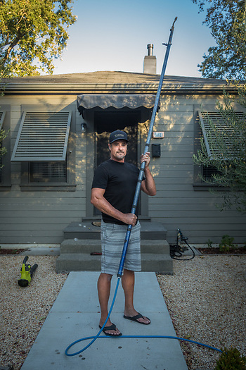 """I need to catch up on the maintenance of my tools.""  -All American Power Wash owner Monte Cobb stands in front of his Calistoga home with his power washer extention. (Clark James Mishler)"